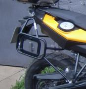 Buy everything for the motorcycle. Luggage systems, side frames, arches